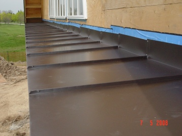 Metal standing seam flashing